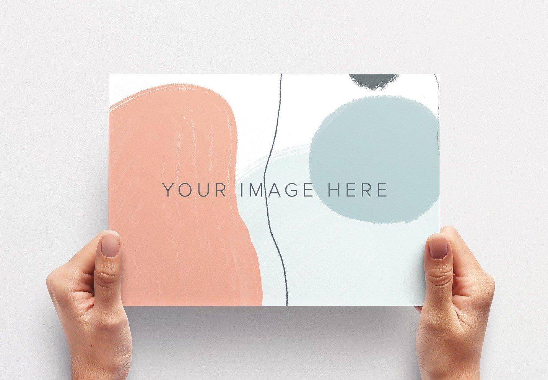 hands holding paper mockup image03