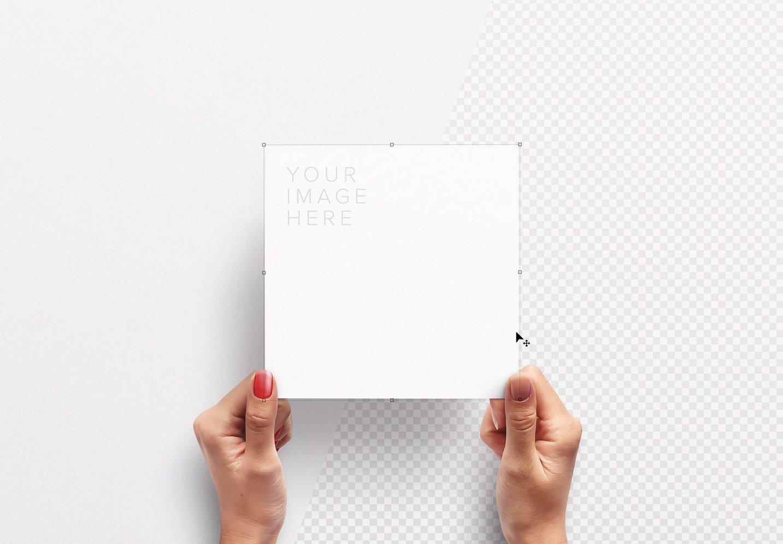 hands holding square paper mockup image01