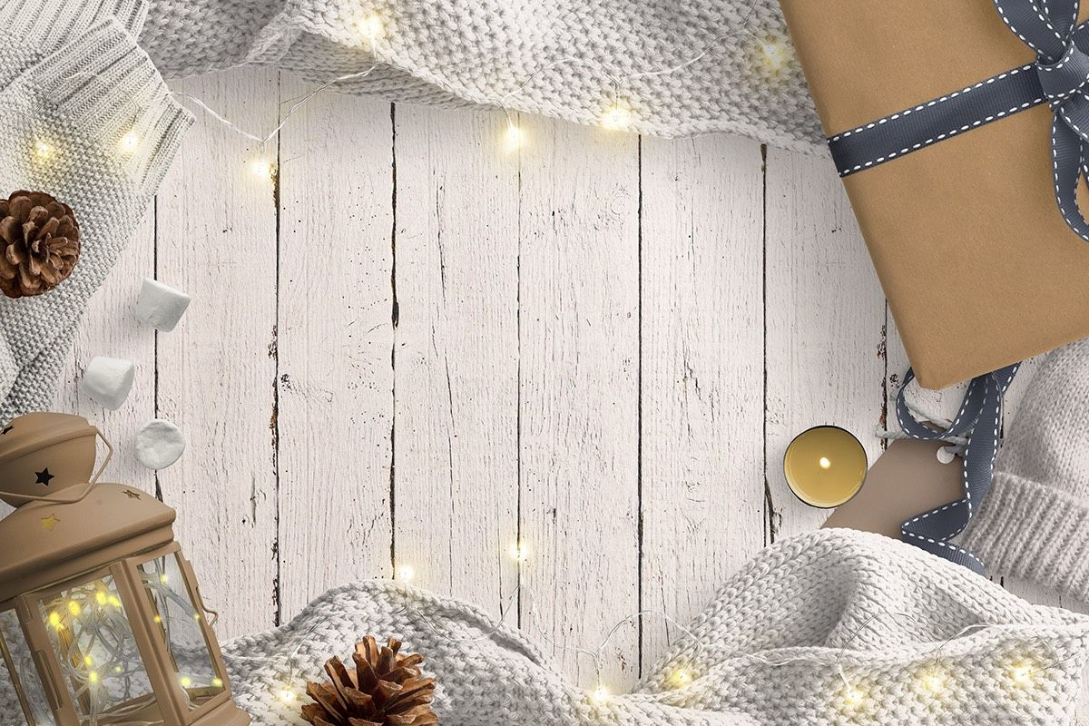 Cozy Winter Scene with Fairy Lights Lantern Gift Pinecones and Woollen Sweater