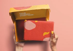 Hands Holding Opened Postal Box and Package Mockup image01
