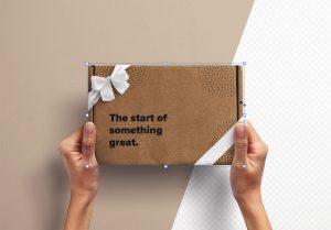Hands Holding Postal Box with Ribbons thumbnail 2
