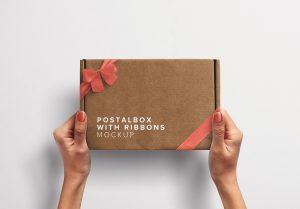 Hands Holding Postal Box with Ribbons thumbnail